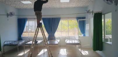 A workman in one of the clinic's rooms